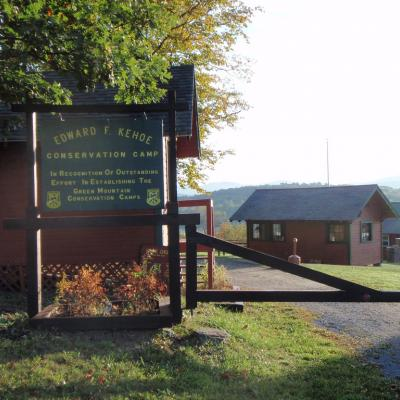 Camp Kehoe sign and cabin